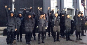 Blackout Collective taking Direct Action in front of the Oakland Police Department Headquarters